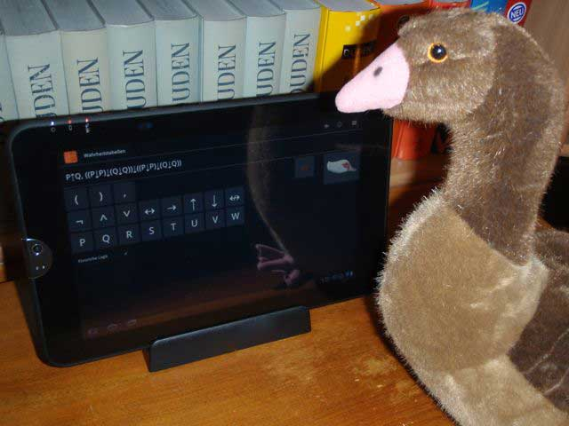 [A goose using logic software on a tablet computer]